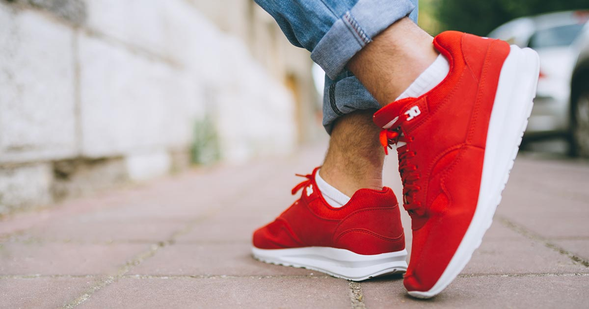 Man wearing red sneakers