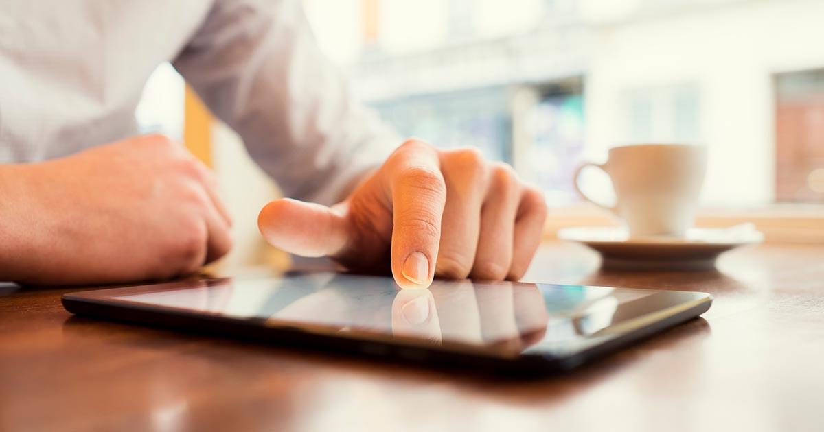 Man on digital tablet