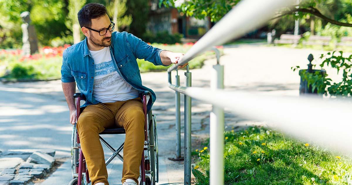 Man in a wheelchair climbing up