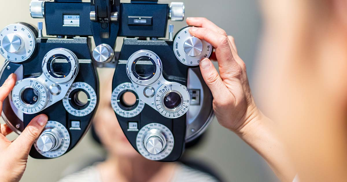 Eye care professional in state of the art facility using eye technology equipment