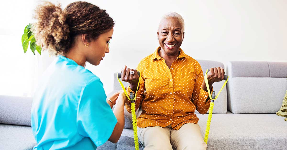 a nurse helping a patient with physical therapy exercises